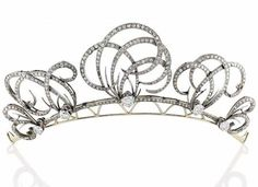 DIAMOND TIARA. Adorned with five scroll, set with diamonds, gold setting, total weight:. 50.20 gr, ca. 1900, convertible to a brooch or ear clips