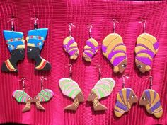 HAND CARVED EARRINGS MADE FROM LIGHT WOOD..... FOR THE QUEENS...!!! https://etsy.com/shop/NUBIANTHRONE