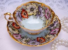 Paragon Tea Cup and Saucer Yellow Purple by TeacupsAndOldLace