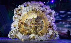 """Naomi Cabrera Pulido, wearing a creation called """"A hundred years of history"""" by Spanish designer Leo Martinez, reacts after being crowned queen in the annual carnival queen election gala at Santa Cruz de Tenerife, on the Spanish Canary Island of Tenerife, March 2, 2011."""