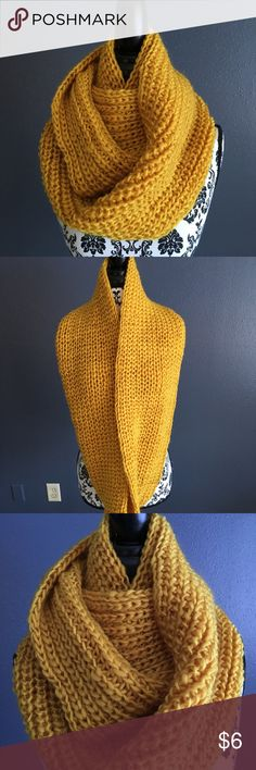 Infinity Scarf Beautiful yellow knit infinity scarf.  Can be worn a variety of ways..will compliment any outfit. Accessories Scarves & Wraps