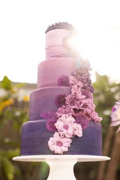 Photographer: Stephanie Yonce   Featured Cake: A Cake To Remember LLC via Ruffled; We love this purple ombre tiered wedding cake! How gorgeous