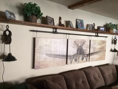 DIY industrial pipe to hang pictures and pulley lights....