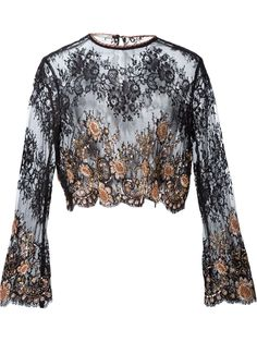 This Alessandra Rich embellished lace blouse is the perfect way to celebrate arrival of the festive season, shop now at Farfetch