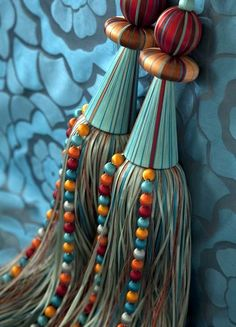 TURQUOISE CARNIVAL TEMARI TIEBACK Exquisite and beautifully crafted, with a vibrant fringe in a medley of double satin ribbon with silk covered spheres and crystal beaded strand detailing, finished with the finest silk covered bobbles Diy Tassel, Tassels, Crazy Quilting, Diy Bordados, Tassel Curtains, Glands, Curtain Tie Backs, Crystal Beads, Creations