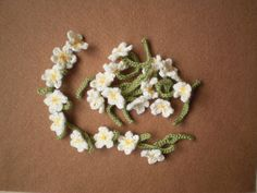 Daisy Chain crochet pattern by Frankie Brown | instructions for crocheting simple flowers with holes in the stems so they can be strung together in a daisy chain