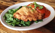 Vegan Calzone - V Calzone stuffed with organic tomatoes, onions, hearts of palm, potato, oregano, and basil on a bed of lettuce, served with a house-made marinara sauce and cracked red pepper. — at French Meadow Bakery & Café. Check out our FB for the other two specials this week,  https://www.facebook.com/frenchmeadowcafe