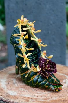 These would be my shoes!  Botanical shoe made with croton leaves,  orchids and rose.  By Françoise Weeks