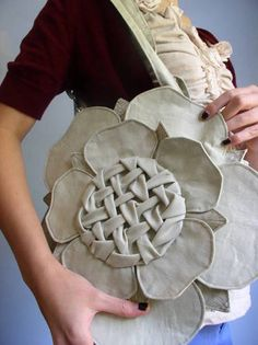 Tudor Rose Purse. That's so cool, I might wear it myself. Wonder if they do one in red and white, the Tudor blending of the red rose of the Lancasters & the white rose of the Yorks.