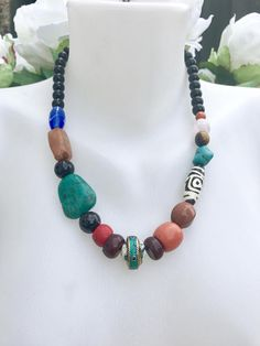 Chunky necklace, tibetan jewellery, statement necklace, Tibetan necklace, beautiful necklace using mostly vintage beads threaded in waxed hemp, 17mm centre piece shell bead in brass, 2pc 12x6mm dark brown horn beads, red 7x12mm clay bead, 2pc 12mm black cats eye beads, 27x22mm turquoise