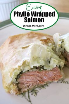 EASY Phyllo Wrapped Salmon with pesto and cheese is special enough for a dinner party and easy enough for a weeknight dinner! #salmon #phyllo #phyllosalmon