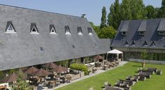 Les Manoirs de Tourgéville Deauville Located in a 7-hectare park, 20 km from Honfleur and 5.4 km from Deauville, Les Manoirs de Tourgéville features a large indoor swimming pool, tennis court, a cinema and a well-being space.