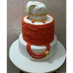 10 Amazing Nigerian Traditional Wedding Cakes Nigerian Traditional Wedding Cake LoveweddingsNG Sweet Indulgence<br> Looking for inspiration for your traditional wedding cake, we have 10 amazing wedding cakes to inspire you. Nigerian Traditional Wedding, Traditional Wedding Cakes, Traditional Cakes, Amazing Wedding Cakes, Wedding Cakes With Flowers, Amazing Cakes, African Wedding Cakes, African Cake, Carriage Cake