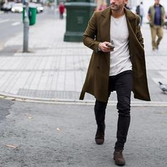 Olive green coat, white t shirt , jeans and brown chelsea boot by @kosta_williams ✨ [ www.RoyalFashionist.com ]