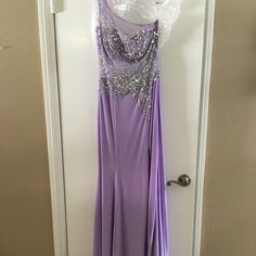 Purple Prom Dress Long, purple dress for prom or other occasion. Has: rhinestones, sheer midsection, one shoulder, and leg slit. Worn once. In good condition. Dresses Prom