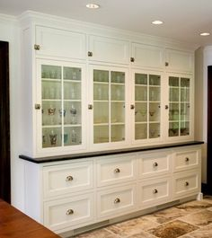 built-in china cabinet, with a countertop that matches kitchen and