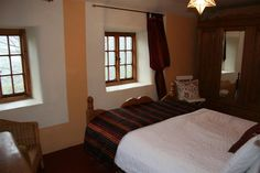 Main bedroom with kingsize bed and glorious views of the hills.