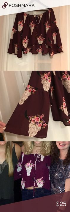 Altar'd State off the shoulder Boho top Super cute maroon top with floral cow skull accents. Can be worn on or off the shoulder. The top is slightly cropped. Looks great with a bralette, high waisted jeans, and booties. Altar'd State Tops
