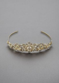 "A spectacular crown-like tiara for the bride who is looking for that bling factor!  Tiara features clear beading and crystals for that show stopping statement piece!  3"" high. 15"" long.  Available in Silver. Imported."