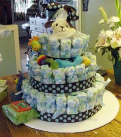 For a fun decoration that doubles as a gift for a baby shower, make a diaper cake out of disposable diapers. Here is an illustrated,  step by step guide on how to create a diaper cake.