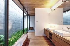 Wall House by Singapore-based architects FARM. #architecture #interiors #design #bathroom #wood #glass