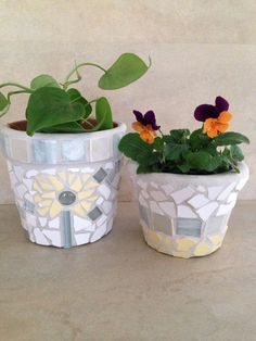 A personal favorite from my Etsy shop https://www.etsy.com/listing/226425778/handmade-mosaic-flower-pot-terracotta