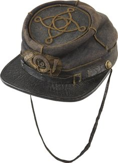 This historic cap was worn by Captain Paul Oliver, Co. E, 12th N.Y. Vol. Infantry, who had it knocked off his head by a Confederate bullet when wounded at the battle of Gaines Mill, June 27, 1862.