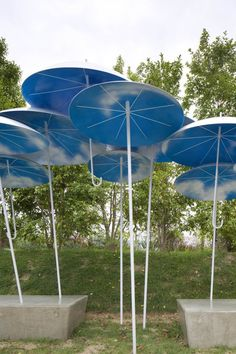 A Bus Stop Shelter Made Of Permanently Installed Umbrellas