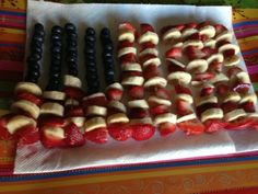 4th of July Dessert: American Flag skewers of red (strawberries), white (bananas) and blue (blueberries)