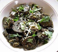 Gujarati Patra Recipe Snack. Taro leaves, coconut, seeds, dal.