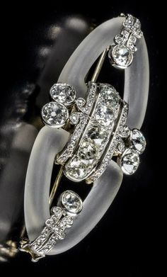 An Art Deco gold, crystal and diamond double clip brooch, about 1930. #ArtDeco #ArtDecoDiamond