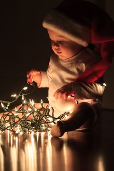 Baby Christmas--first year. So sweet. I want a pic like this of my son. His 1st Christmas.