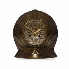 An Amsterdam School bronze mantle clock, the design attributed to Th. van Reijn for Winkelman & Van der Bijl, Amsterdam 1920's - Sotheby's