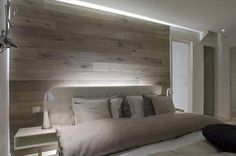 BEDROOM: Slightly darker shades needed, but I like the idea of wood paneling and soft indirect lighting