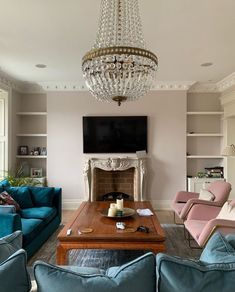 Living room with pink and plush blue accents #livingroom
