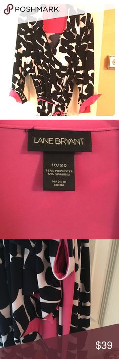 Lane Bryant navy/white and hot pink ruffle dress This super cute faux wrap dress is a pretty navy and white pattern with hot pink trim. Hot pink trim on the sleeves and ruffles down the front. Perfect for work or play. Elastic waist down and self belt reversable with navy trim and hot pink. Make a statement in this beauty. In mint condition. Only worn once. Size 18/20.  Bundle and save. Lane Bryant Dresses Midi