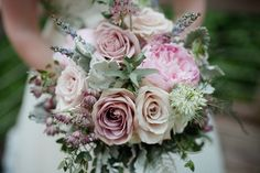 Bridal bouquet with amnesia and quicksand roses, lavender, white nigella, purple astrantia, dusty miller and eucayptus.