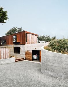 Cor-Ten steel and board-form concrete give the exterior a weathered look.