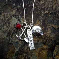 Firefighter's Pride!  This follows up our popular Police Pride with a hand stamped badge #tag, fire engine red Swarovski crystal, ax and shovel charm, and helmet charm!  HOT!