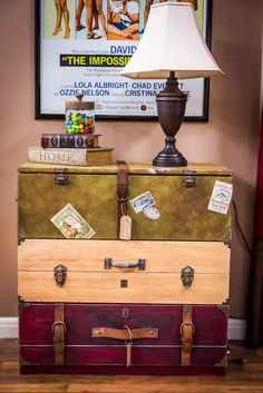 Ok, a dresser, three (or more) fat drawers. Each one painted and given fixtures to look like different types of stacked luggage.: