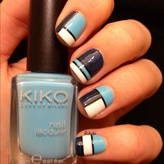 Blue, white and black nails.