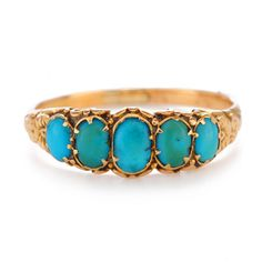 Persian Turquoise cabochons are set in the most beautiful 18K setting ... we just love the prong detail and the irregularity of their color.     Georgian jewelry is the best !