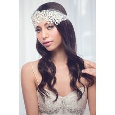 The Tegan Bridal Lace Headband is light ivory beaded lace on soft tulle and is is a stunning statement piece. The lace head piece is 32cm long and has been created so as to follow the curve of your head comfortably.The ribbon is 3cm wide and 90 cm long on either side.  The edges of the ribbon have been finished off with rhinestones. This piece is presented in Roman