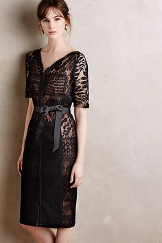 Love the peak-a-boo lace, can't tell if it has a sheath underneath thou... Carissima Sheath - anthropologie.com