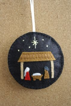 "Nativity Felt Christmas Ornament/ Decoration BY GeorgeNRuby@Etsy: SOLD. * Made using Wool Blend Felt * Black background with hand cut and stitched felt nativity scene. No glue is used. * Embellishments are one side of ornament only * White ribbon attached * Lightly filled with Poly-Fil * Size 3 1/2"" in diameter (9cm)..."