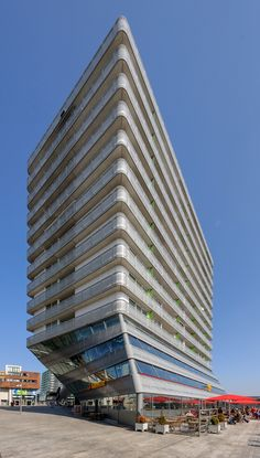 Side by Side, Almere - architect: de Architekten Cie Gigon Guyer, Architectural Photographers, Amazing Buildings, Facade Architecture, Round Corner, Futuristic, Netherlands, Holland, Skyscraper