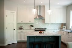 love the globe pendants, subway tile and white cabinetry! Kitchen Tour » Wee Little Wonders