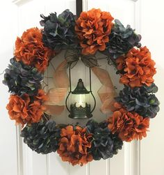Welcome Fall with this gorgeous wreath made with orange and blue artificial hydrangea and accented with a dark green candle lantern and fall colors ribbons. It will instantly add a pop of colors an inviting feel to any room. It's a perfect holiday decor. Fall Ribbon Wreath, Green Wreath, Fall Wreaths, Green Hydrangea, Hydrangea Wreath, Wreath Crafts, Diy Wreath, Wreath Ideas, Festival Decorations