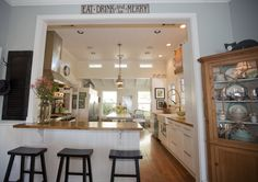 """Opening with countertop-height pass-through, no """"post"""" between doorway and bar, and trimmed to match other doors/windows in the house."""