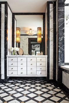 Powder Room - Exquisite craftsmanship using the finest of marble & materials.  Cleverly conceived - stunning.